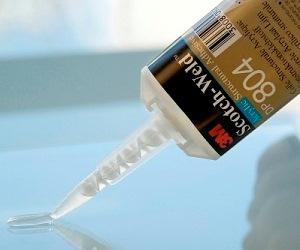 Epoxy and acrylic adhesive