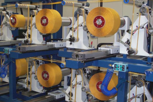 spooling reels for long-length adhesive rolls